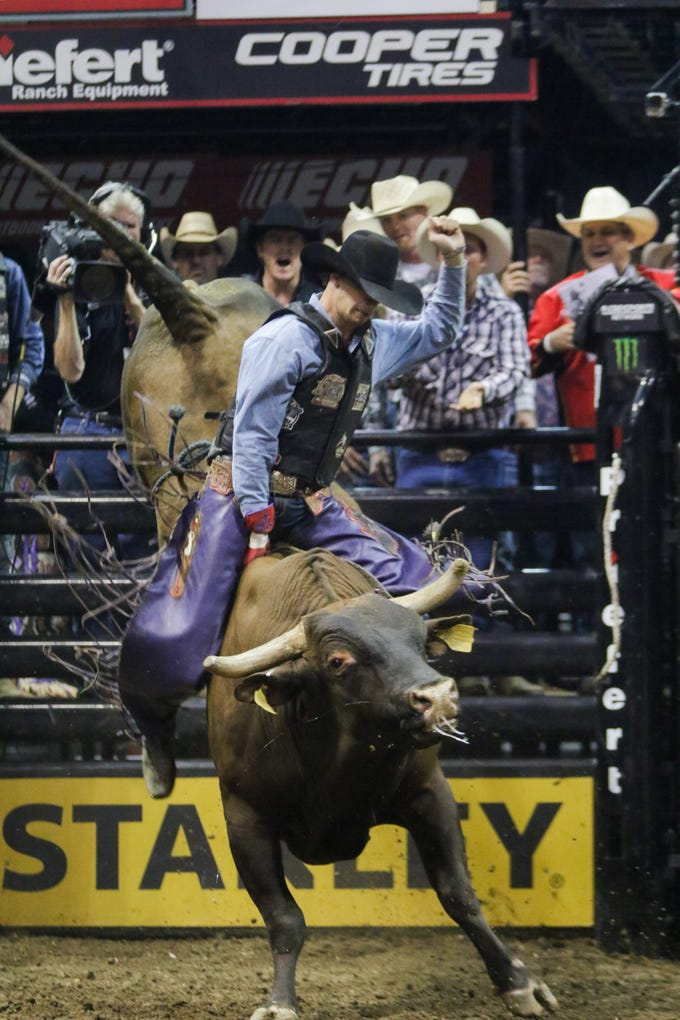 Professional Bull Rider  Mason Lowe, Exeter, Mo, rides Pushing Pills at JQH Arena Saturday, September 12, 2015.