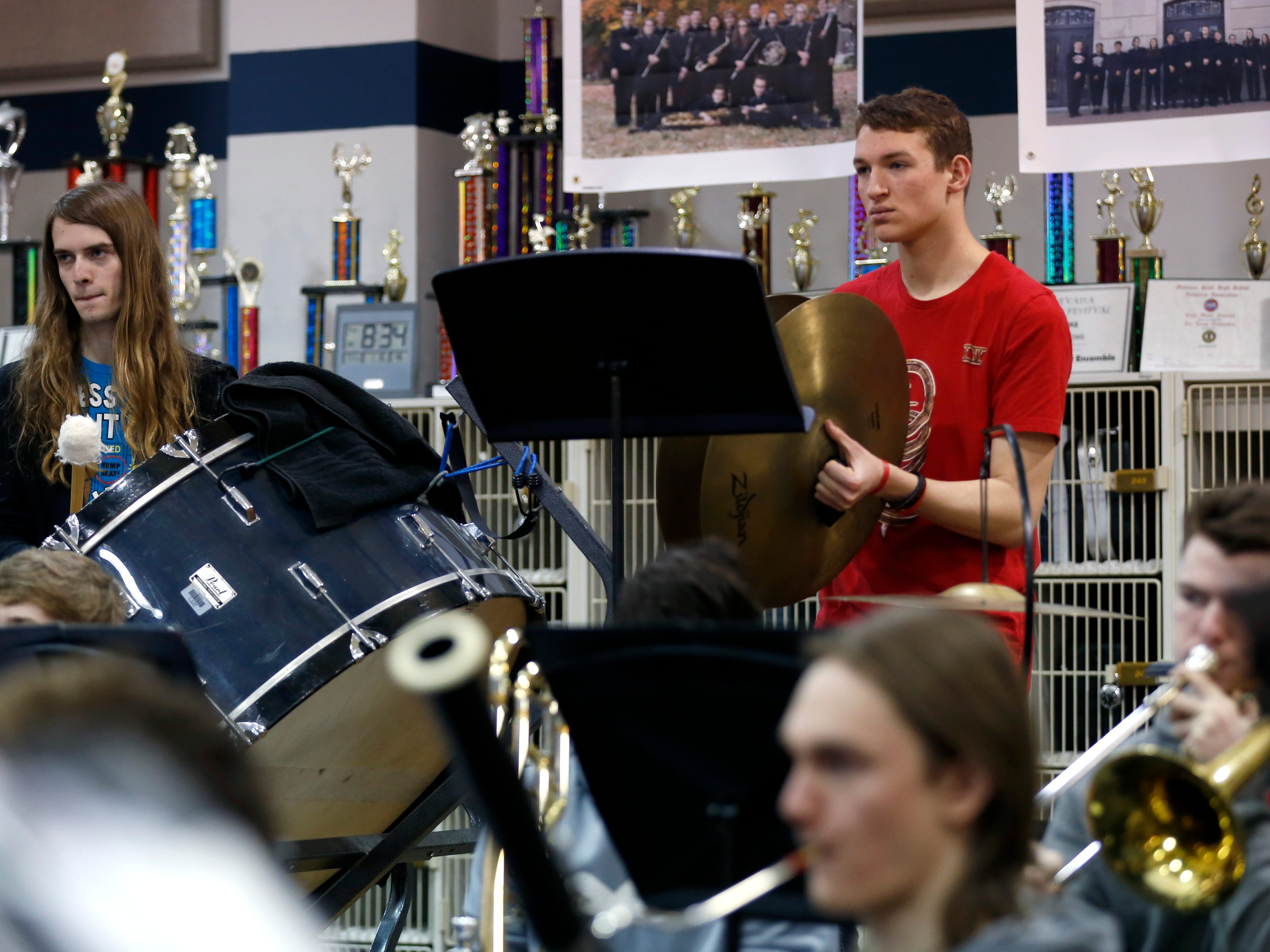 Nolan Musick, a Central High School senior, plays cymbals during band practice on Wednesday, Jan. 16, 2018. The 53-student wind ensemble will be a featured at the annual state conference of the Missouri Music Educators Association next week.