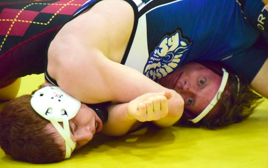 Fort Defiance's Braylon Sandy, left, picks up back points against Stuarts Draft's Clayton Wagoner during their 152-pound quarterfinal bout at the 30th News Leader Wrestling Tournament at Stuarts Draft High School in Stuarts Draft, Va., on Tuesday, Jan. 15, 2019.