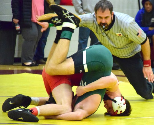Riverheads' G.W. Shultz pins Wilson Memorial's Jack Rebholz during their 126-pound quarterfinal bout at the 30th News Leader Wrestling Tournament at Stuarts Draft High School in Stuarts Draft, Va., on Tuesday, Jan. 15, 2019.