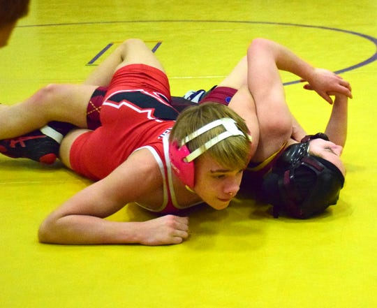 Riverheads' Jude Robson, left, picks up back points against Stuarts Draft's Jaylee Hatcher during their 106-pound quarterfinal bout at the 30th News Leader Wrestling Tournament at Stuarts Draft High School in Stuarts Draft, Va., on Tuesday, Jan. 15, 2019.