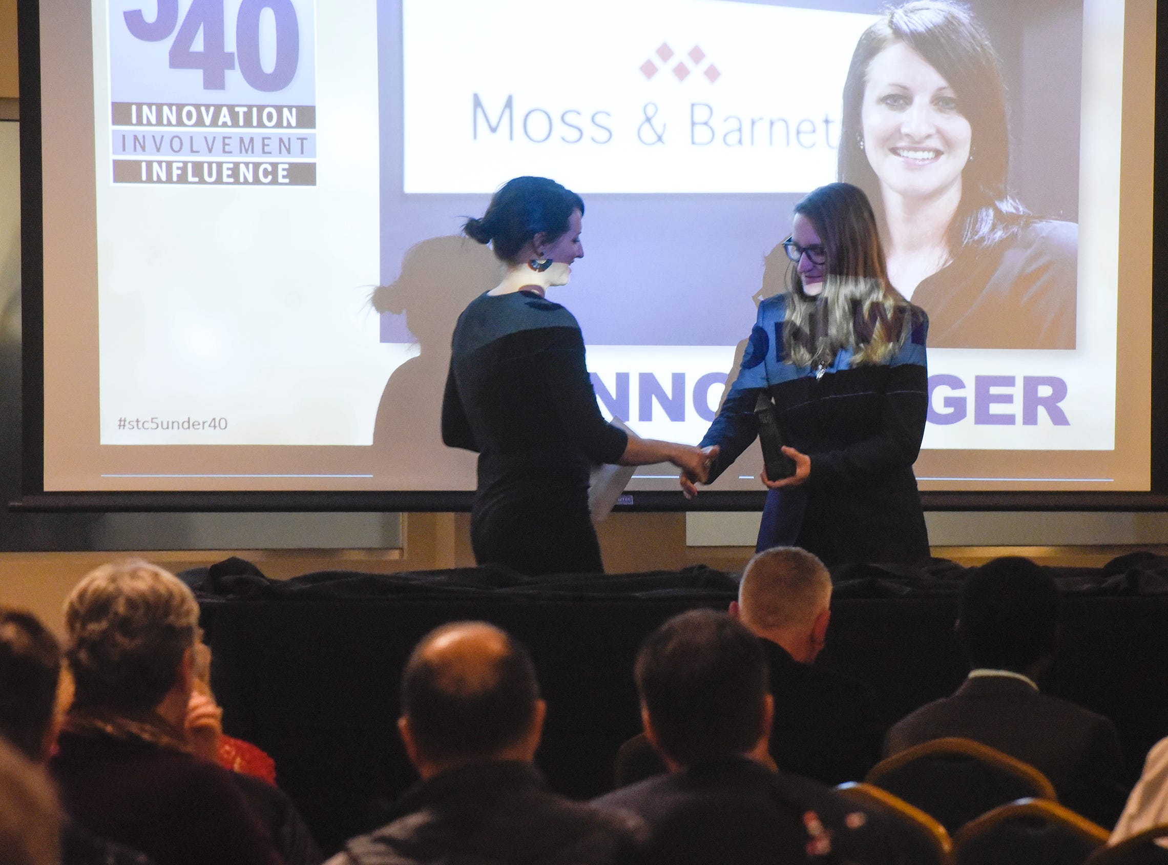 Shannon Wiger receives her award during the 5 Under 40 Awards program Tuesday, Jan. 15, in St. Cloud.