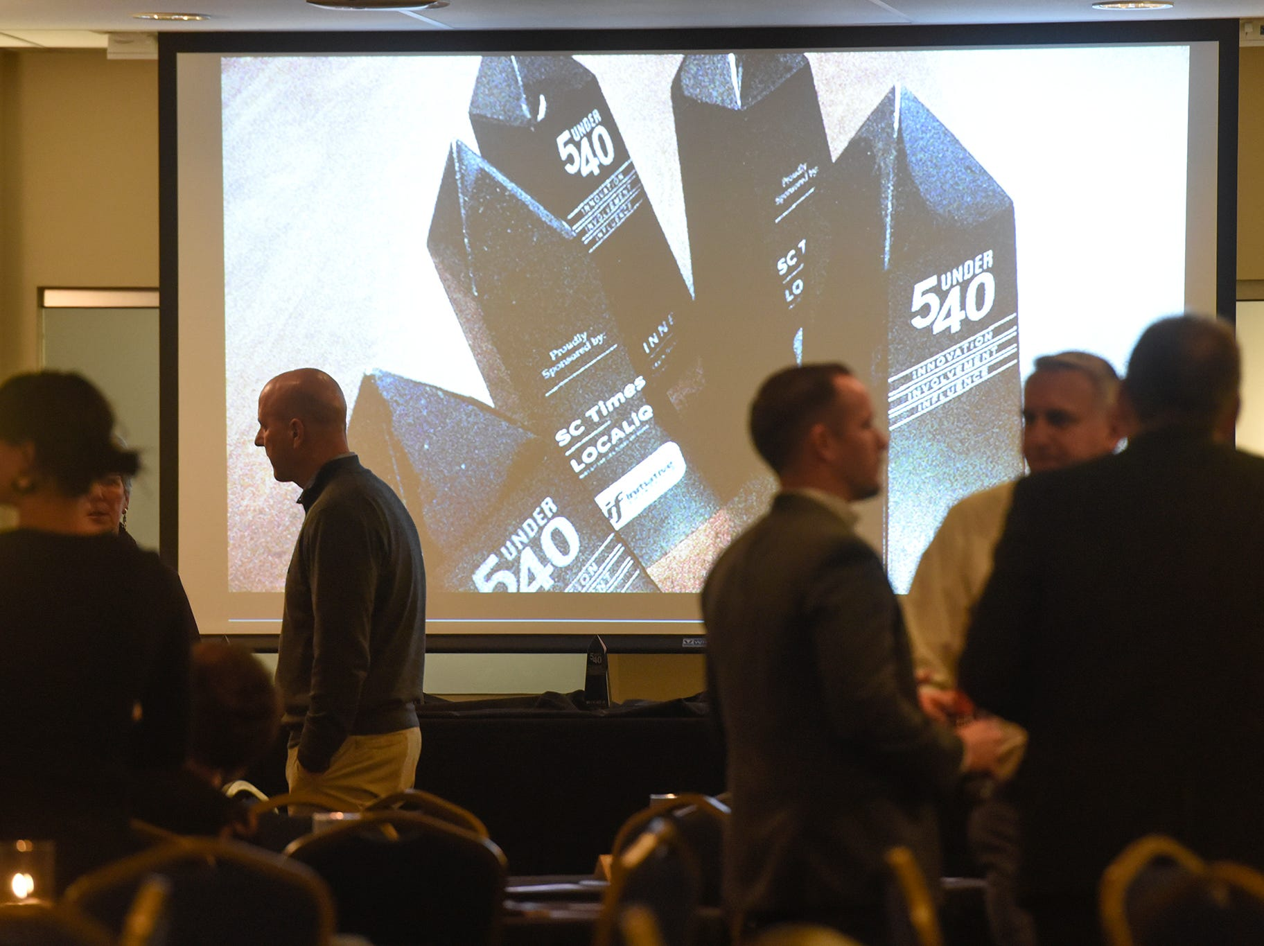 People get ready for the 5 Under 40 Awards program to start Tuesday, Jan. 15, in St. Cloud.