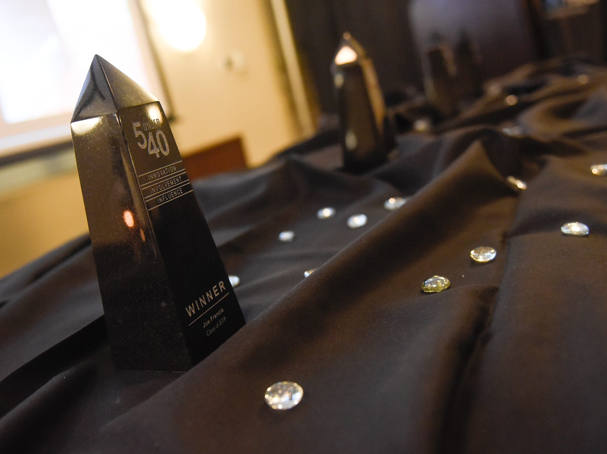 Awards are ready to be presented before the start of the 5 Under 40 Awards program Tuesday, Jan. 15, in St. Cloud.