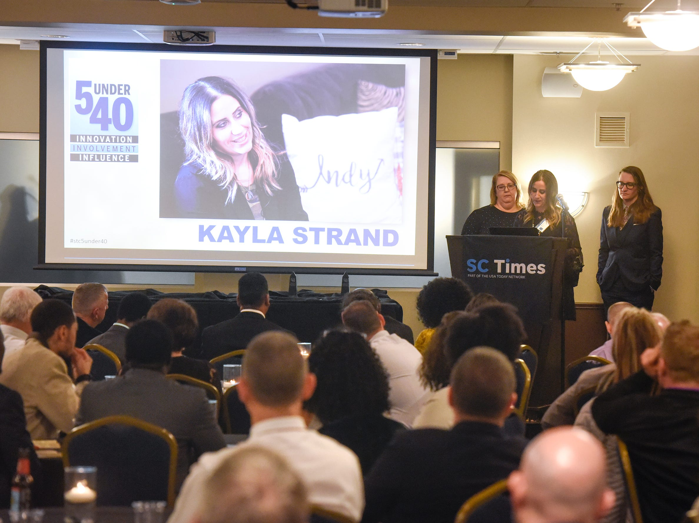 Kayla Strand speaks after receiving her award during the 5 Under 40 Awards program Tuesday, Jan. 15, in St. Cloud.