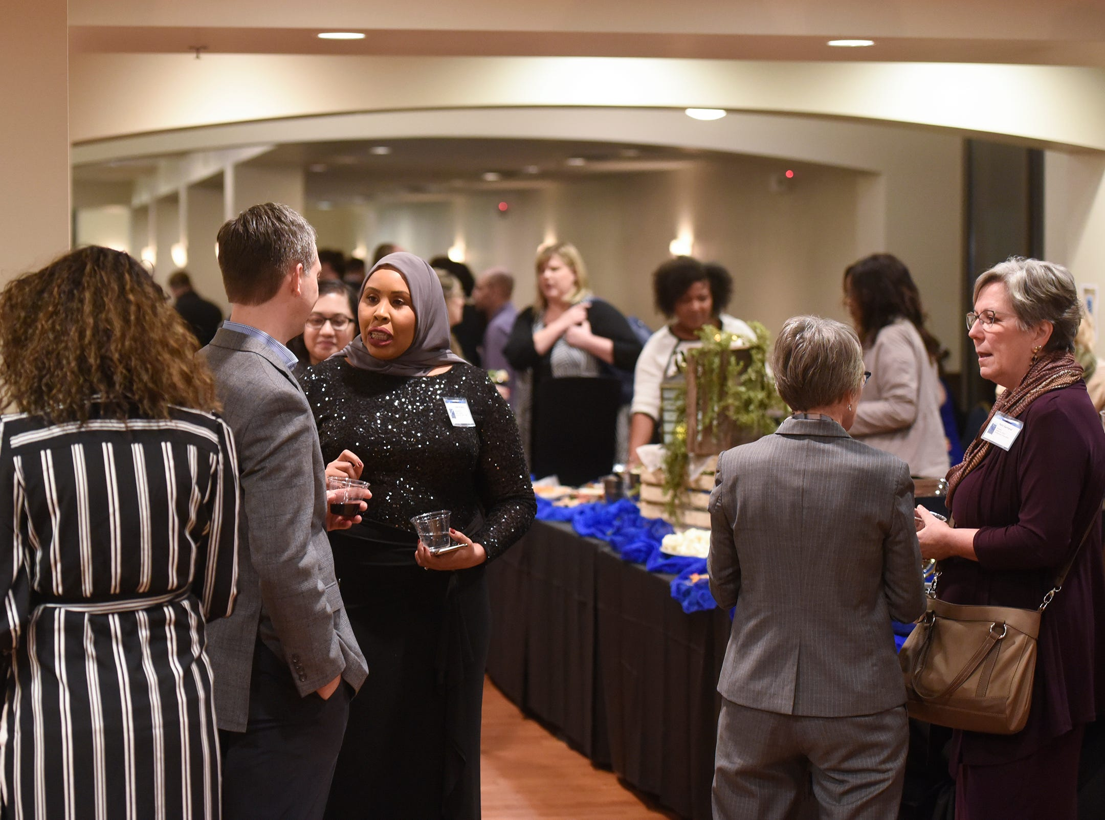 People gather before the start of the 5 Under 40 Awards program Tuesday, Jan. 15, in St. Cloud.