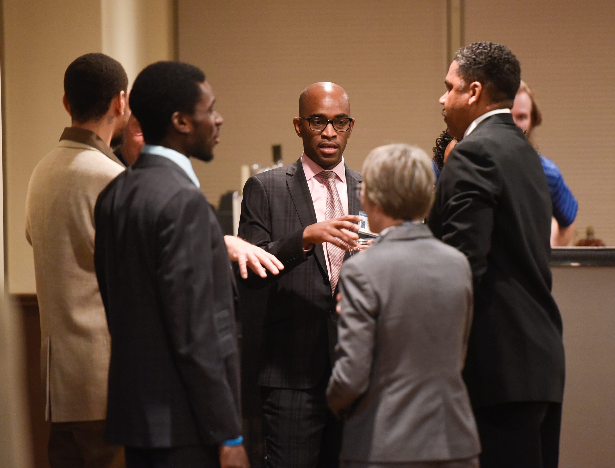 Ryan Daniels talks with friends before the start of the 5 Under 40 Awards program Tuesday, Jan. 15, in St. Cloud.