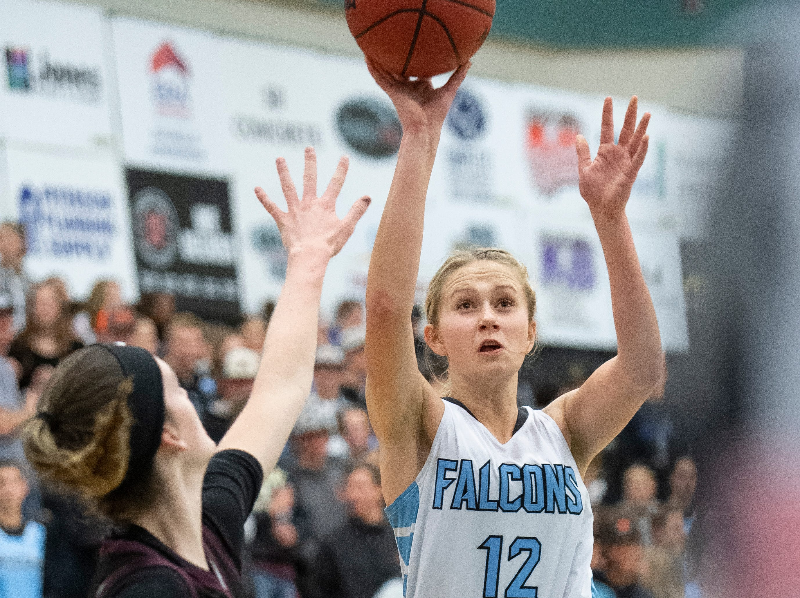 Canyon View High School freshman Harlee Nicoll (12) scores a basket against Pine View at CVHS Tuesday, January 15, 2019. The CVHS Falcons won, 48-46.