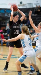 Pine View High School sophomore Averi Papa (20) keeps the ball high above Canyon View defenders at CVHS Tuesday, January 15, 2019. The CVHS Falcons won, 48-46.