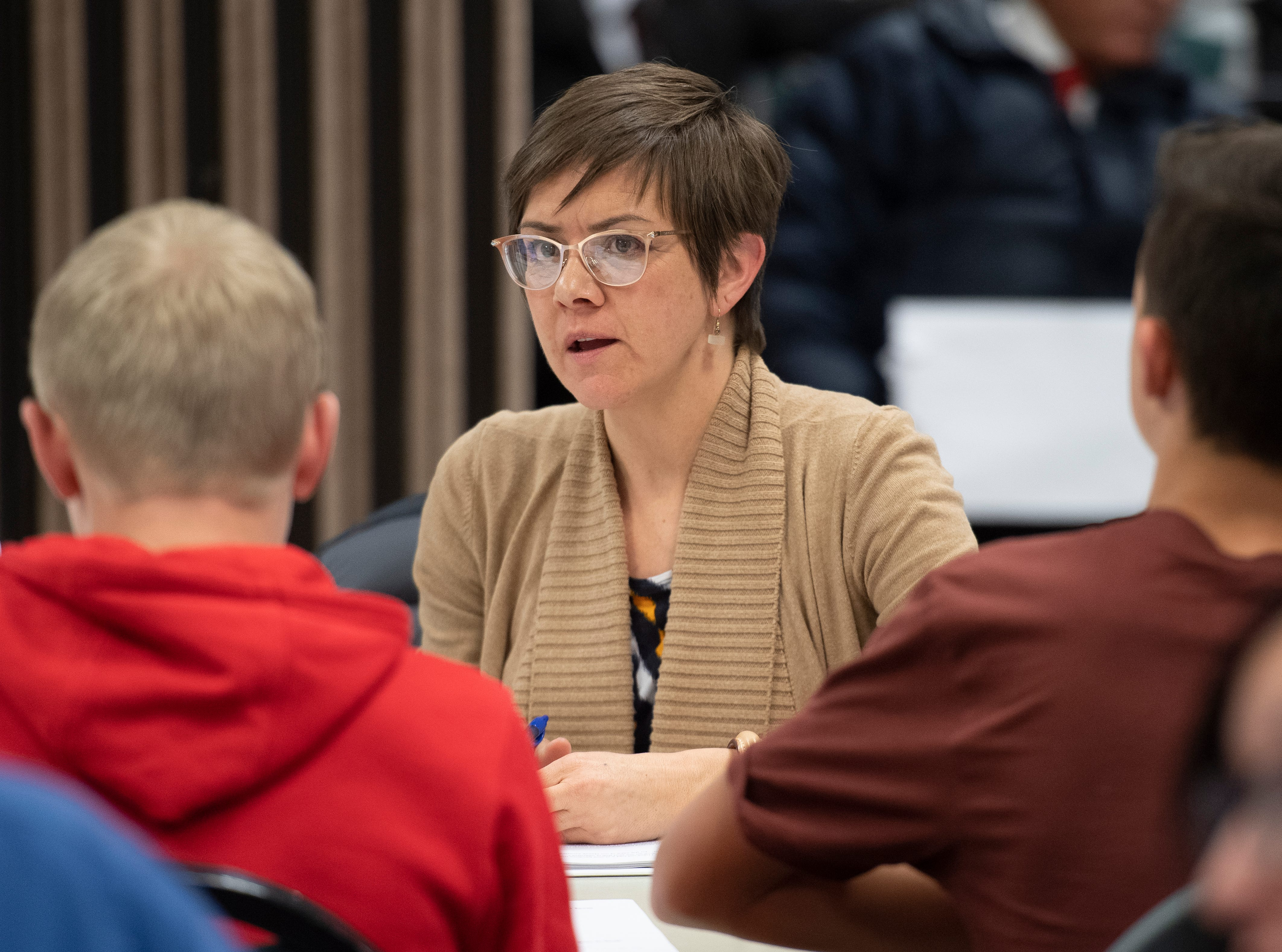"""An Iron County School Board commission discusses changing the """"Redmen"""" name of Cedar High School at the school district building Tuesday, January 15, 2019. The 24-member panel voted 17-7 in favor of changing the name."""
