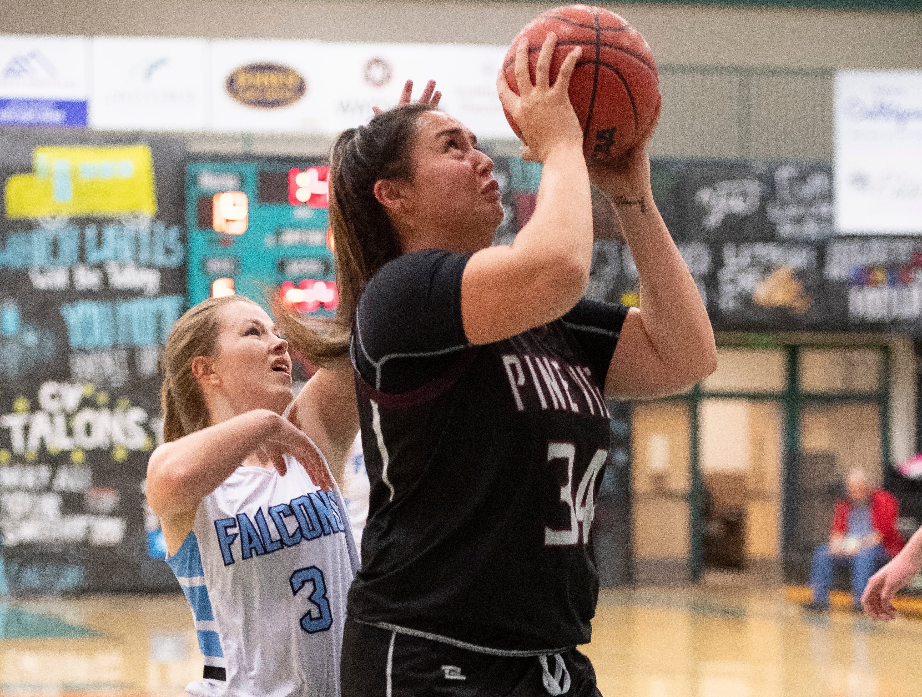 Pine View High School junior Leiani Tonga (34) takes a shot against Canyon View at CVHS Tuesday, January 15, 2019. The CVHS Falcons won, 48-46.