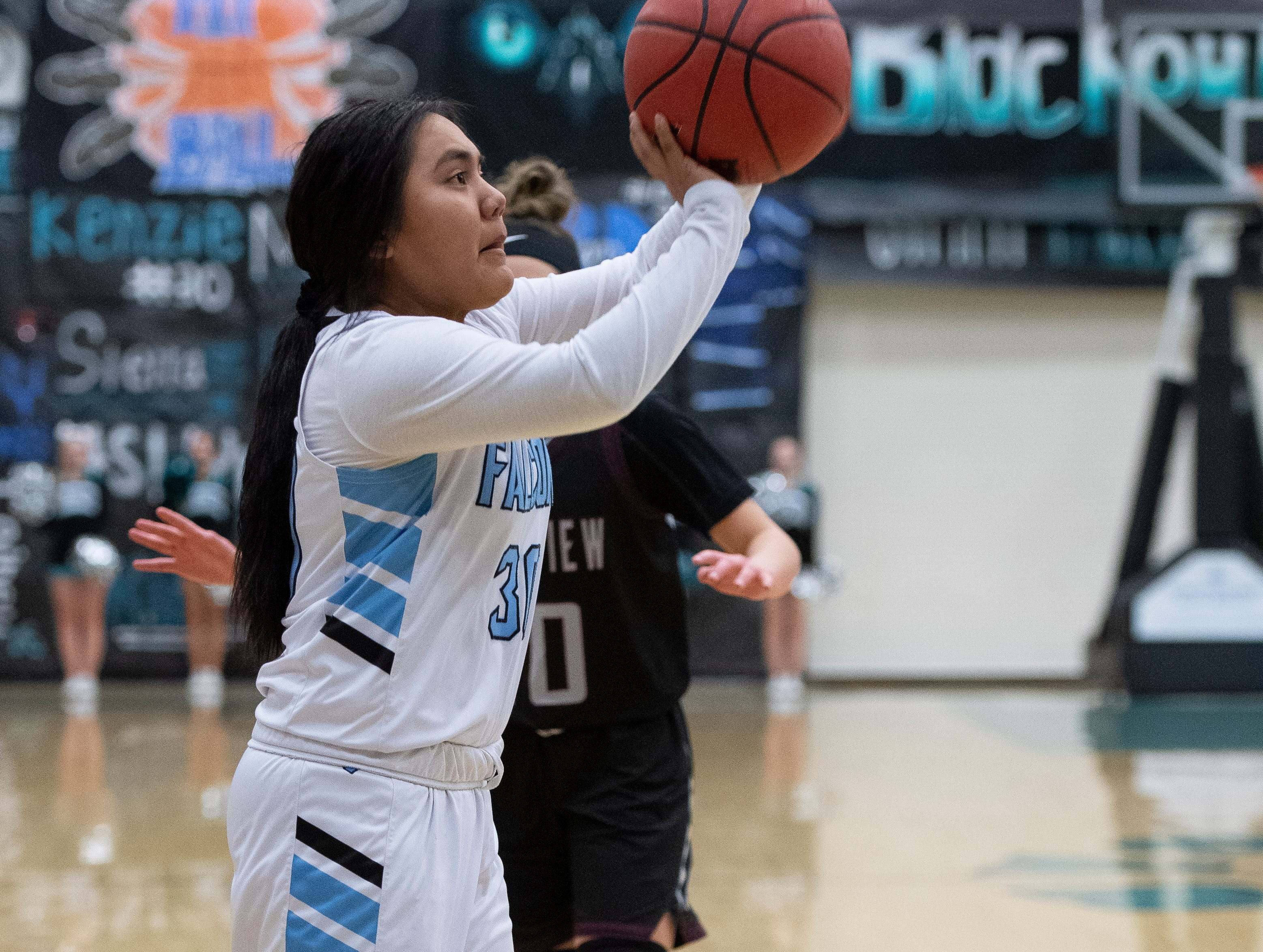 Canyon View High School sophomore Mackenzi Whitehair (30) takes a shot against Pine View at CVHS Tuesday, January 15, 2019. The CVHS Falcons won, 48-46.