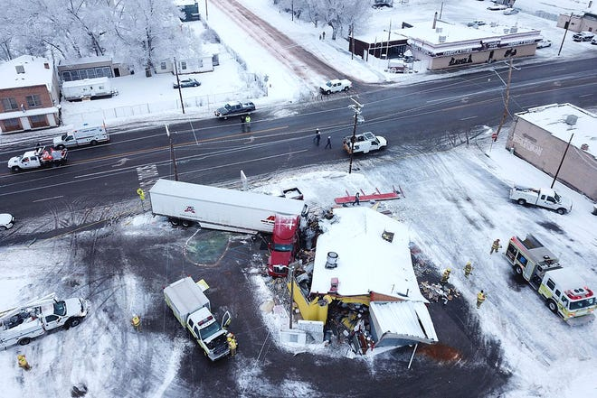 This drone photo released by the Utah Highway Patrol shows a restaurant that was hit by truck in Wellington, Utah, Wednesday, Jan. 16, 2019. Utah authorities say athe tractor-trailer rig crashed into the restaurant, flattening the business and injuring three people. (Utah Highway Patrol via AP)