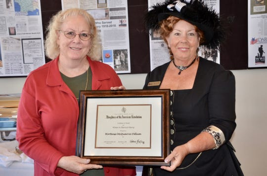 Color Country Chapter Member Dixie Bell Miller presents the Hortense McQuarrie Odlum's Women in History award to Teresa Orton, DUP Museum Director.