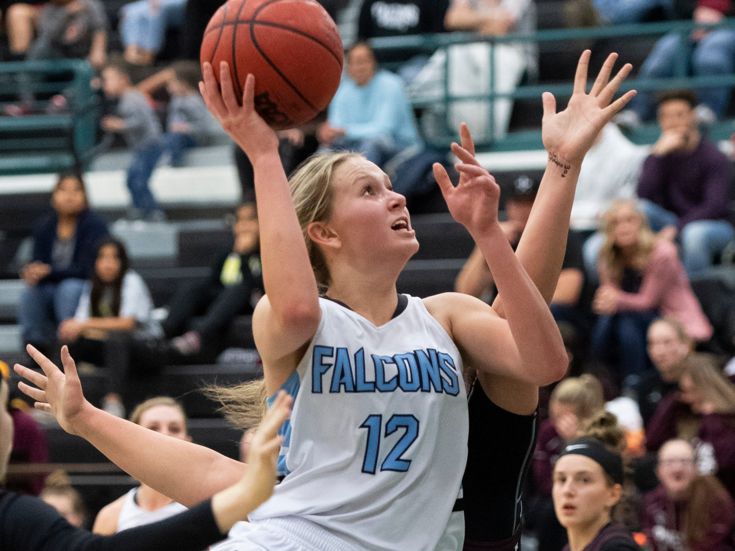 Canyon View High School freshman Harlee Nicoll (12) takes  a shot against Pine View at CVHS Tuesday, January 15, 2019. The CVHS Falcons won, 48-46.