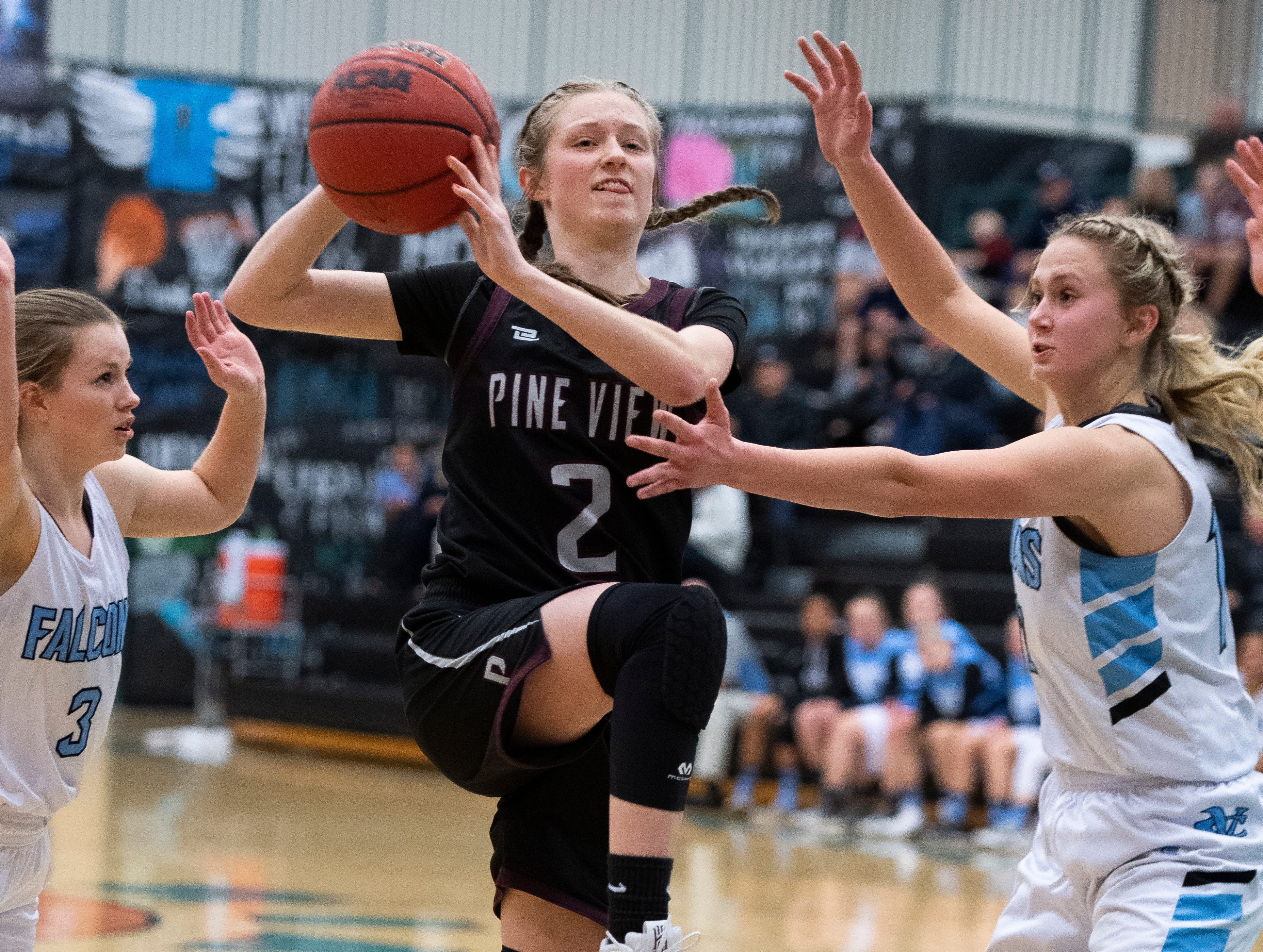 Pine View High School junior Ellie Wilson (2) throws a flying pass against Canyon View at CVHS Tuesday, January 15, 2019. The CVHS Falcons won, 48-46.