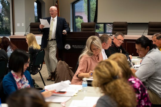 """Iron County School Board director of secondary education Rich Nielsen reads the rules for a commission discussing changing the """"Redmen"""" name of Cedar High School at the school district building Tuesday, January 15, 2019. The 24-member panel voted 17-7 in favor of changing the name."""