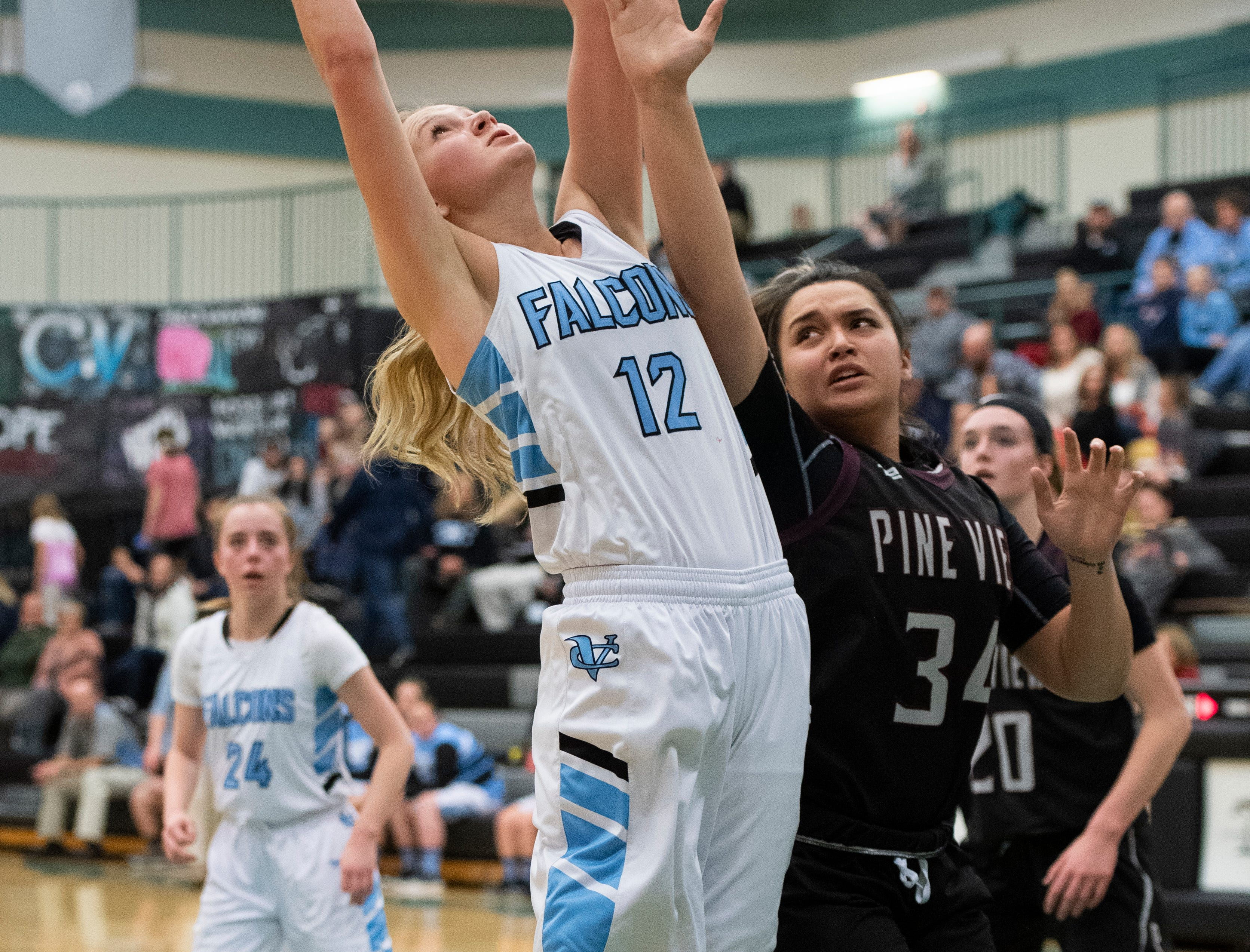 Canyon View High School freshman Harlee Nicoll (12) grabs an offensive rebound against Pine View at CVHS Tuesday, January 15, 2019. The CVHS Falcons won, 48-46.