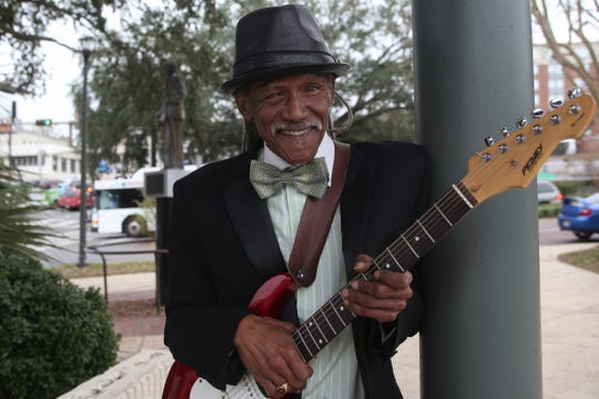 Darryl Steele, local musician and son of the late civil rights leader C.K. Steele, stands in front of a statue of his father at the C.K. Steele Plaza bus station, named after him. Darryl Steele will perform live music there Monday, Jan. 21, 2019, Martin Luther King Day.