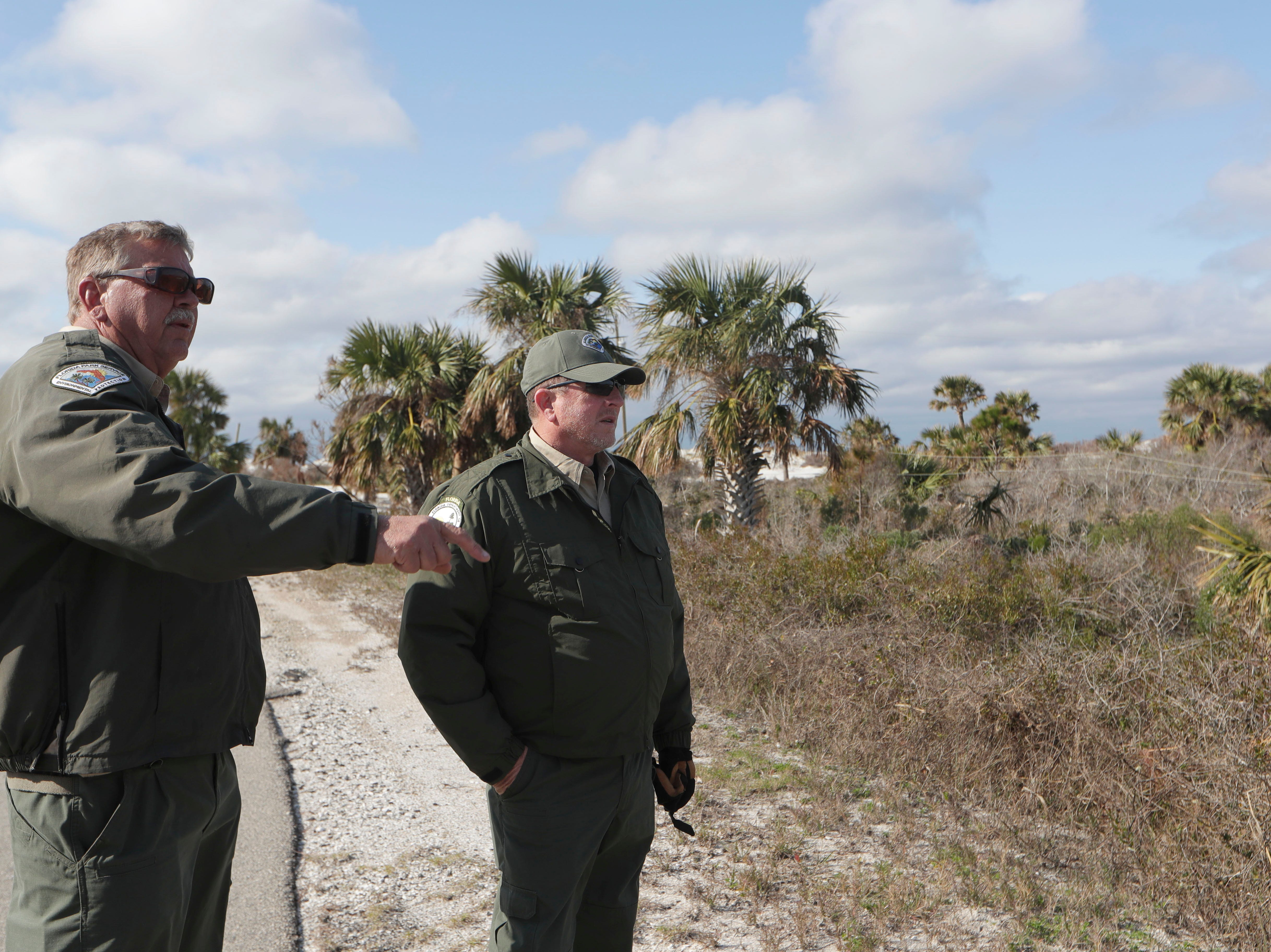 Mark Knapke, park manager with the Florida Department of Environmental Protection, left, and Chuck Hatcher, assistant director of field operations for the Florida Department of Environmental Protection, discuss what a roadway in St. Joseph Peninsula State Park looked like and what needs to be done to fix it, Monday, Jan. 14, 2019. Hurricane Michael left the state park in a total disarray three months prior.