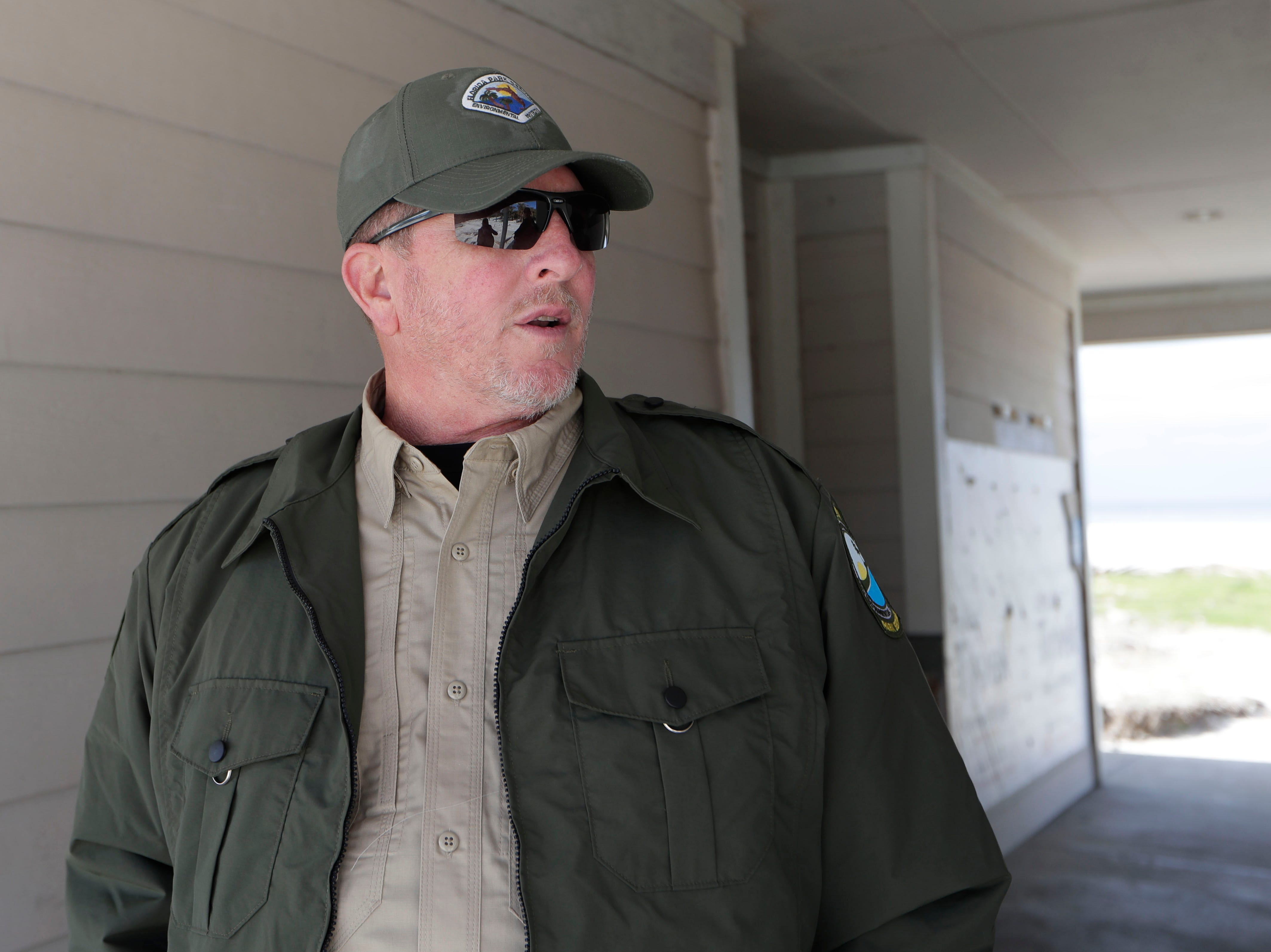 Chuck Hatcher, assistant director of field operations for the Florida Department of Environmental Protection, talks about what he has seen while walking the grounds of St. Joseph Peninsula State Park, Monday, Jan. 14, 2019. Hurricane Michael left the park in total disarray, Oct. 10, 2018.