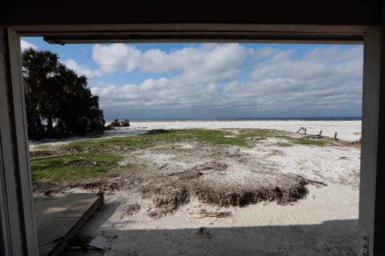 The view from a restroom in St. Joseph Peninsula State Park, Monday, Jan. 14, 2019. A wall once prevented this view from the seat of the toilet but Hurricane Michael ripped the front wall off creating this scene.