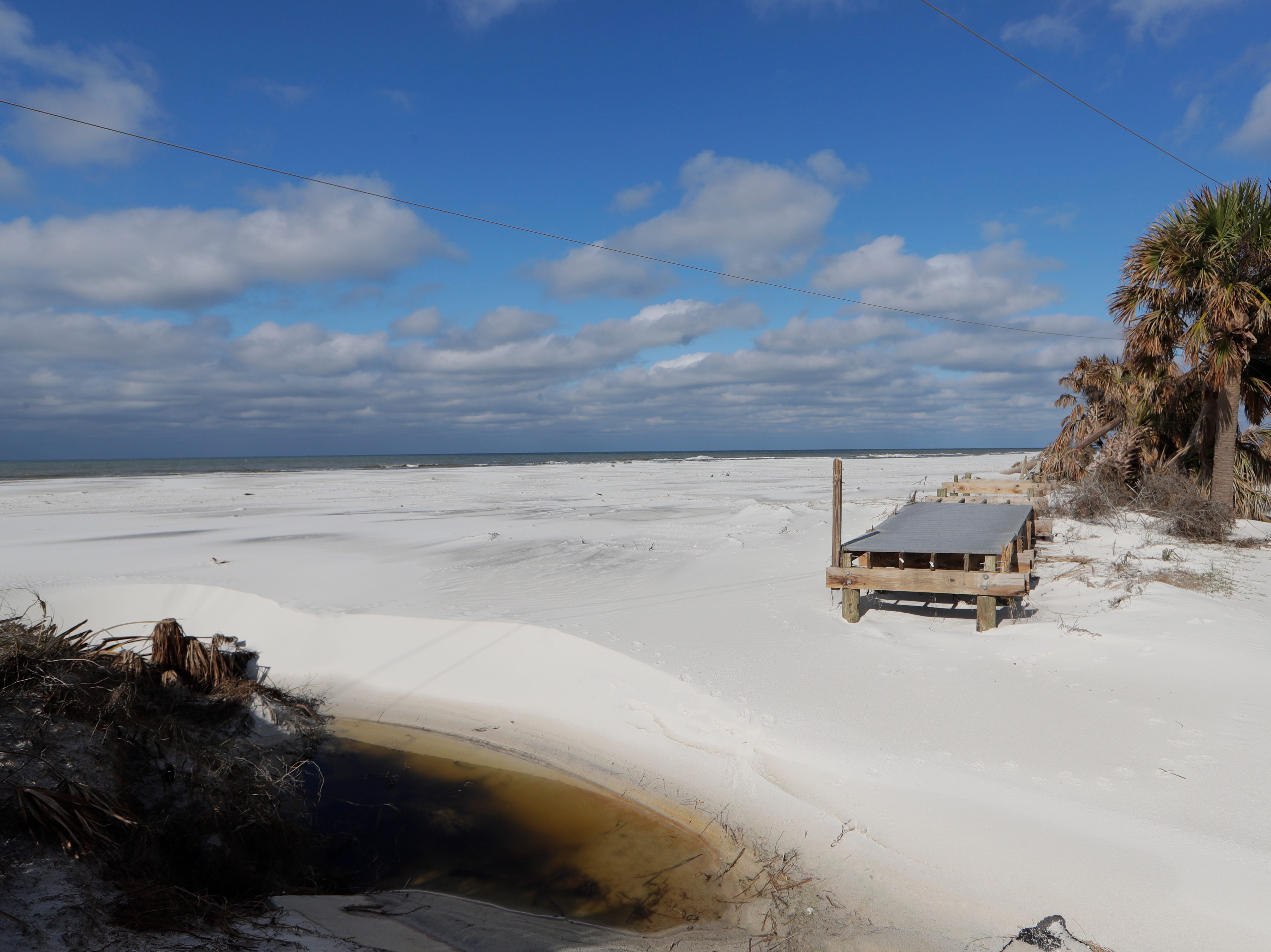 A portion of the boardwalk in St. Joseph Peninsula State Park connecting the campgrounds to the shoreline sits on the beach, Monday, Jan. 14, 2019. Hurricane Michael hit the panhandle Oct. 10, 2018.