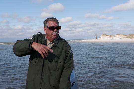 Mark Knapke, park manager for the Florida Department of Environmental Protection drives a boat over to St. Joseph Peninsula State Park, Monday, Jan. 14, 2019. Prior to Hurricane Michael, visitors could drive on a road into the campground areas but Hurricane Michael washed it away.