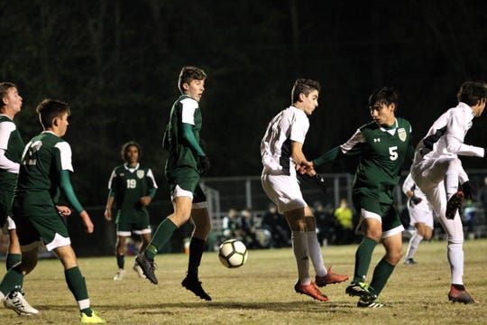 A free kick finds its way past clearance and lands in Lincoln's box without several players aware as Chiles plays at Lincoln on Jan. 15, 2019.