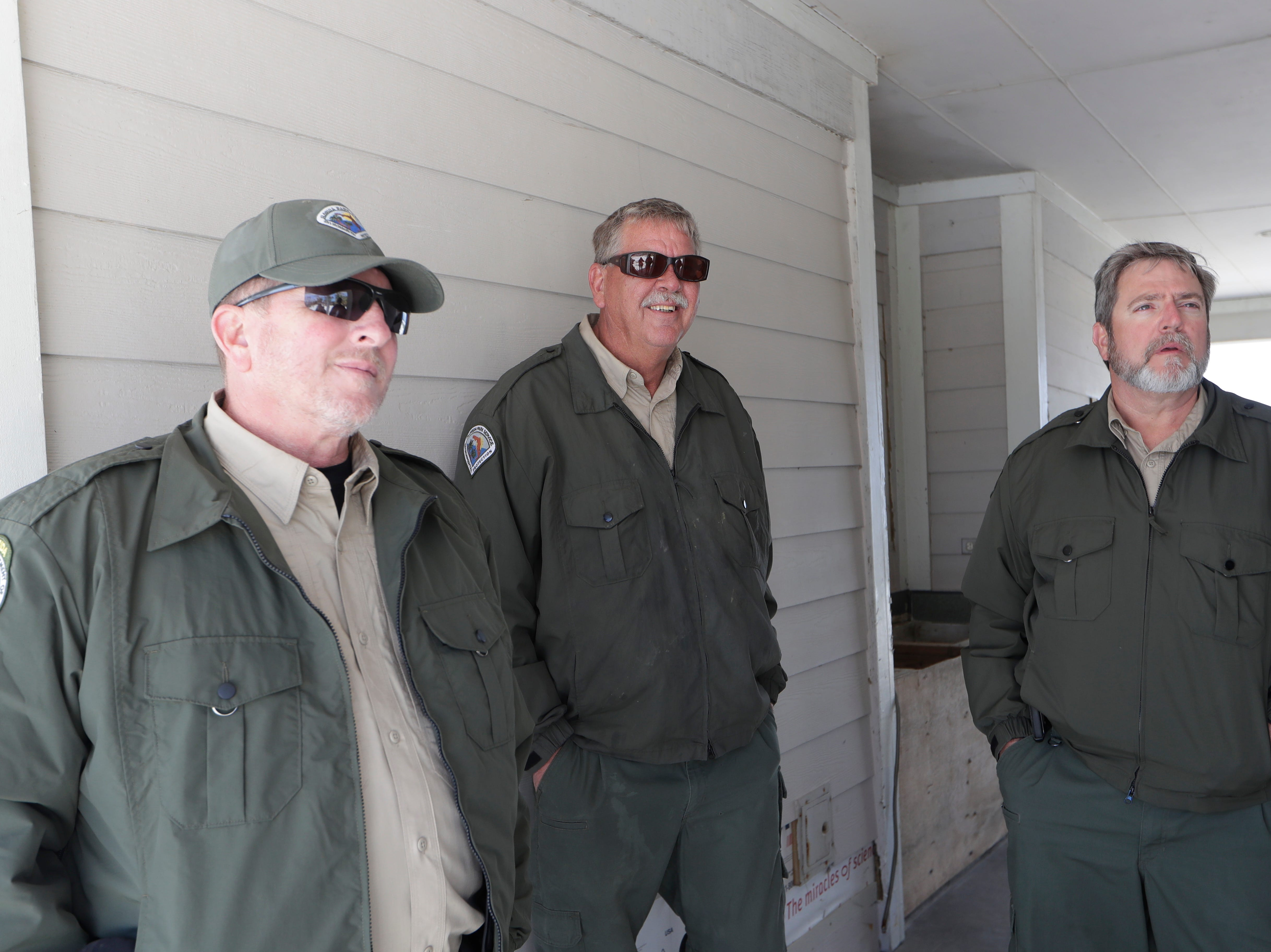 Chuck Hatcher, assistant director of field operations for the Florida Department of Environmental Protection, left, Mark Knapke, park manager for the Florida Department of Environmental Protection, and Warren Poplin, bureau chief for the Florida Department of Environmental Protection, discuss what they saw while walking the grounds of St. Joseph Peninsula State Park, Monday, Jan. 14, 2019. Hurricane Michael hit the panhandle Oct. 10, 2018, and left a mess of destruction behind.