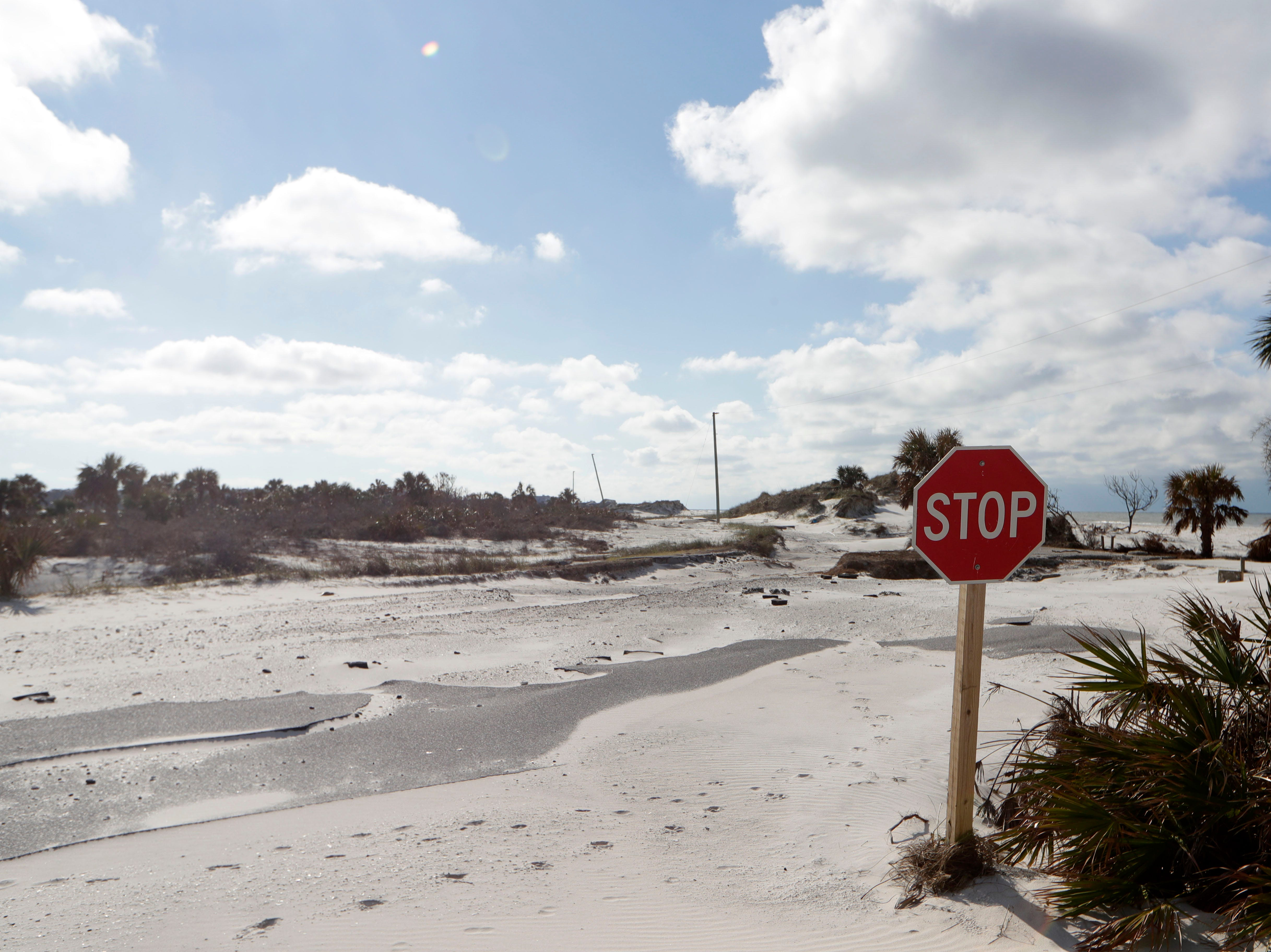 A stop sign still stands in St. Joseph Peninsula State Park, Monday, Jan. 14, 2019, but the road has been washed away by Hurricane Michael. Michael hit the panhandle Oct. 10, 2018.