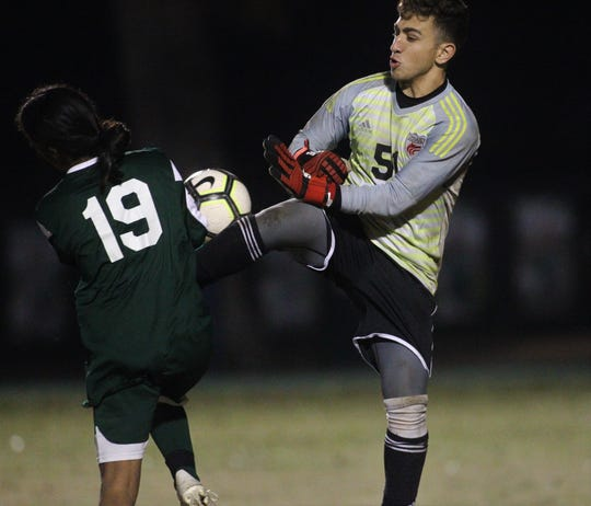 Chiles goalie Abraheim Darwish collides with Lincoln's Ammar Badhabi outside the box during a game at Lincoln on Jan. 15, 2019.
