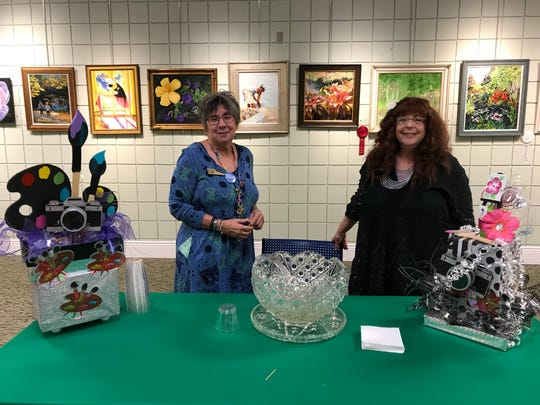 Palm City Cummings Library Branch Manager Carolyn Smith, left, with Francine Panaly at the 2018 Art Show & Sale.