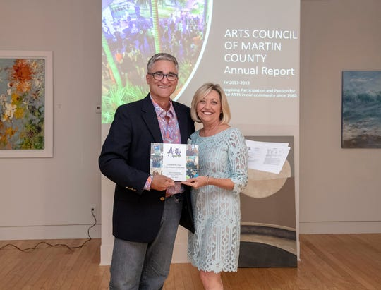 Neil Capozzi with outgoing Arts Council of Martin County board member Nicki Schoonover.