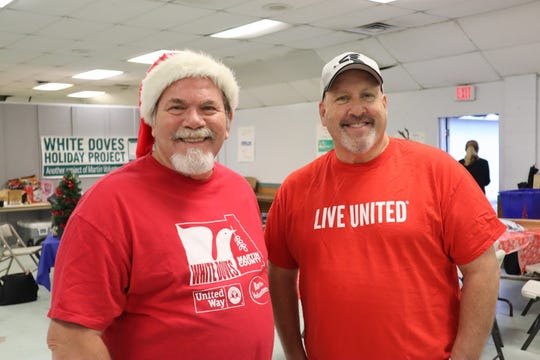 Jim Vojcsik and Elliot Paul, members of LEADERship Martin County Alumni, help sort toys in preparation for the 2018 White Doves distribution days.