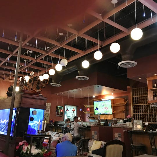 Roy's has several seating options including a sushi bar.