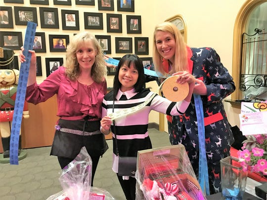 "Florida Arts & Dance Company volunteers Renay Rouse, left, Grace Platon and Nichole Arner, a board member, sell raffle tickets at The Lyric Theatre during a December performance of ""The Nutcracker."""