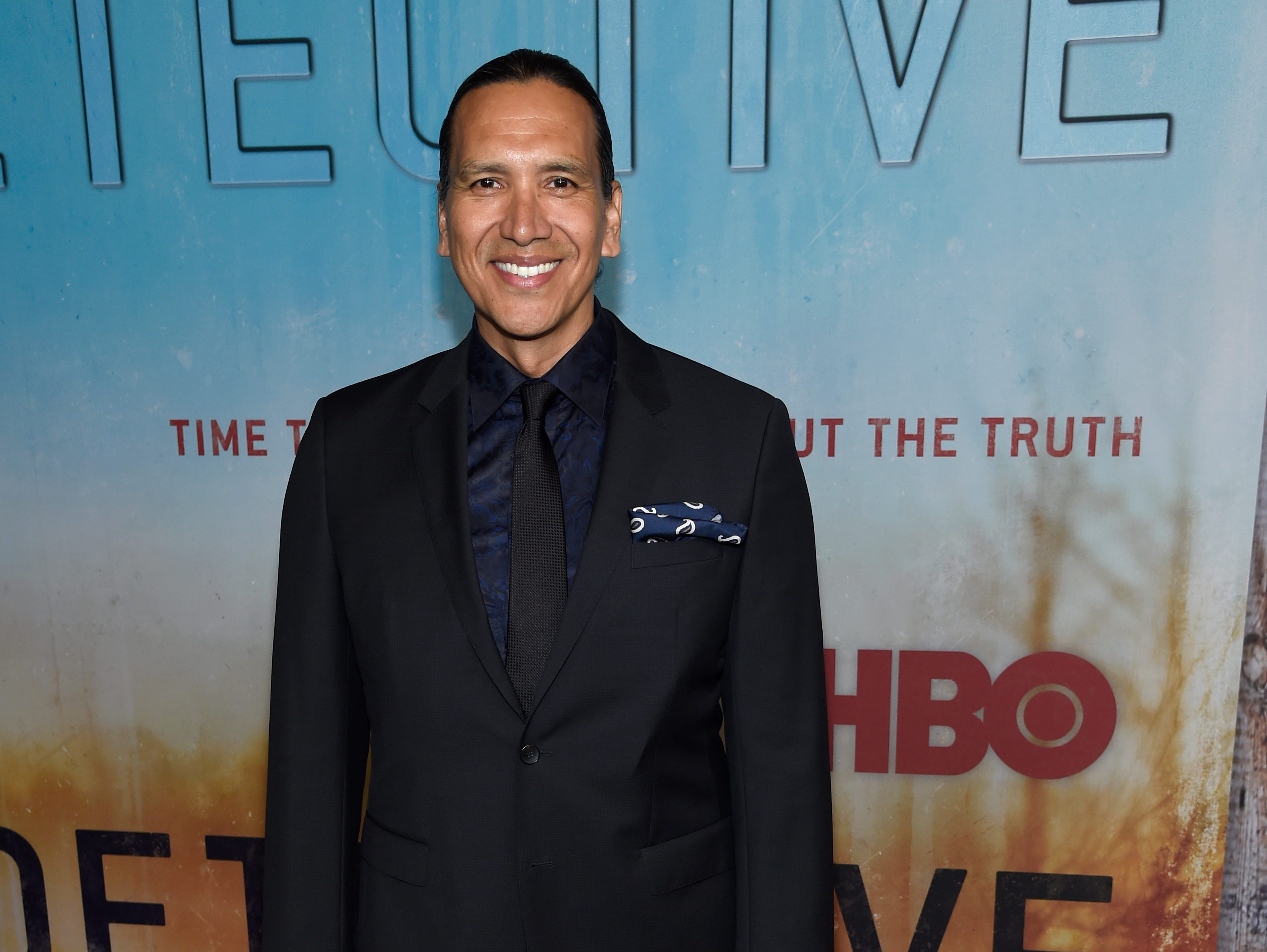 """Michael Greyeyes arrives at the Los Angeles premiere of """"True Detective"""" season 3 at the Directors Guild of America on Thursday, Jan. 10, 2019."""