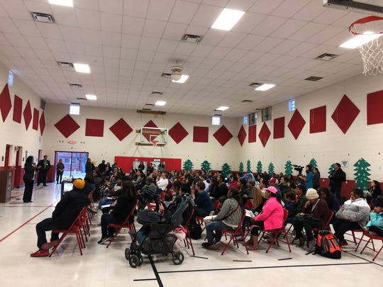 Parents from Beall Elementary listen to a presentation given by EPISD officials on proposed school closures Tuesday in South El Paso.