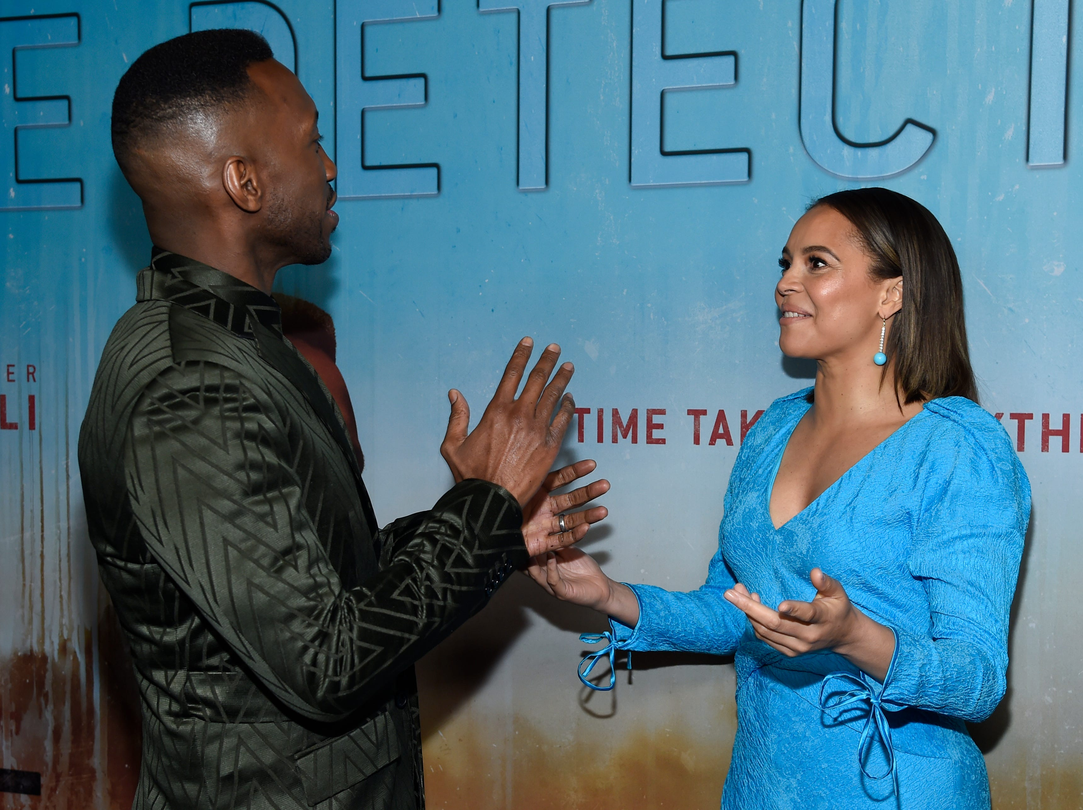 """Mahershala Ali, left, and Carmen Ejogo speak as they arrive at the Los Angeles premiere of """"True Detective"""" season 3 at the Directors Guild of America on Thursday, Jan. 10, 2019."""