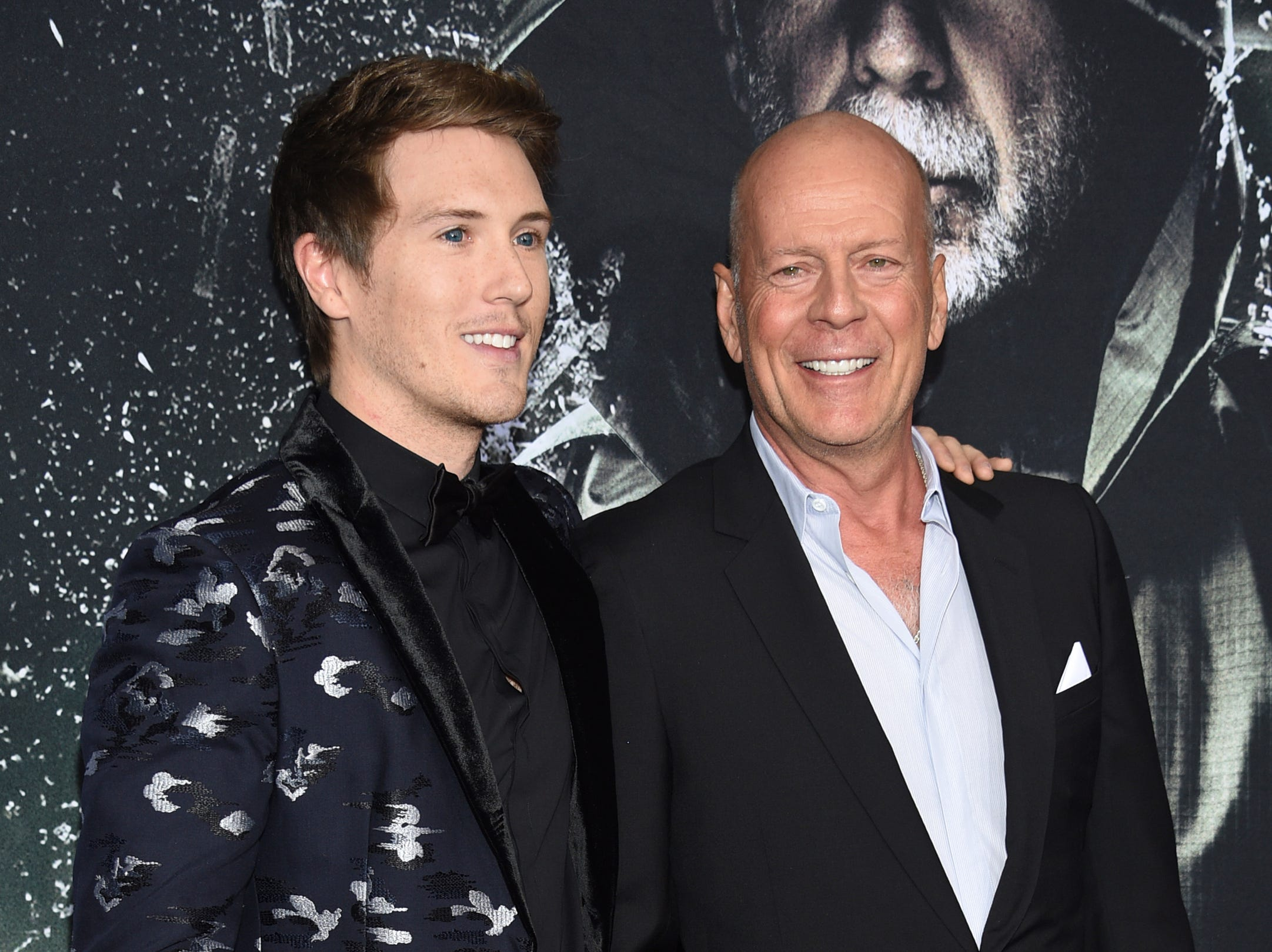 """Spencer Treat Clark, left, and Bruce Willis attend the premiere of """"Glass"""" at the SVA Theatre on Tuesday, Jan. 15, 2019, in New York."""