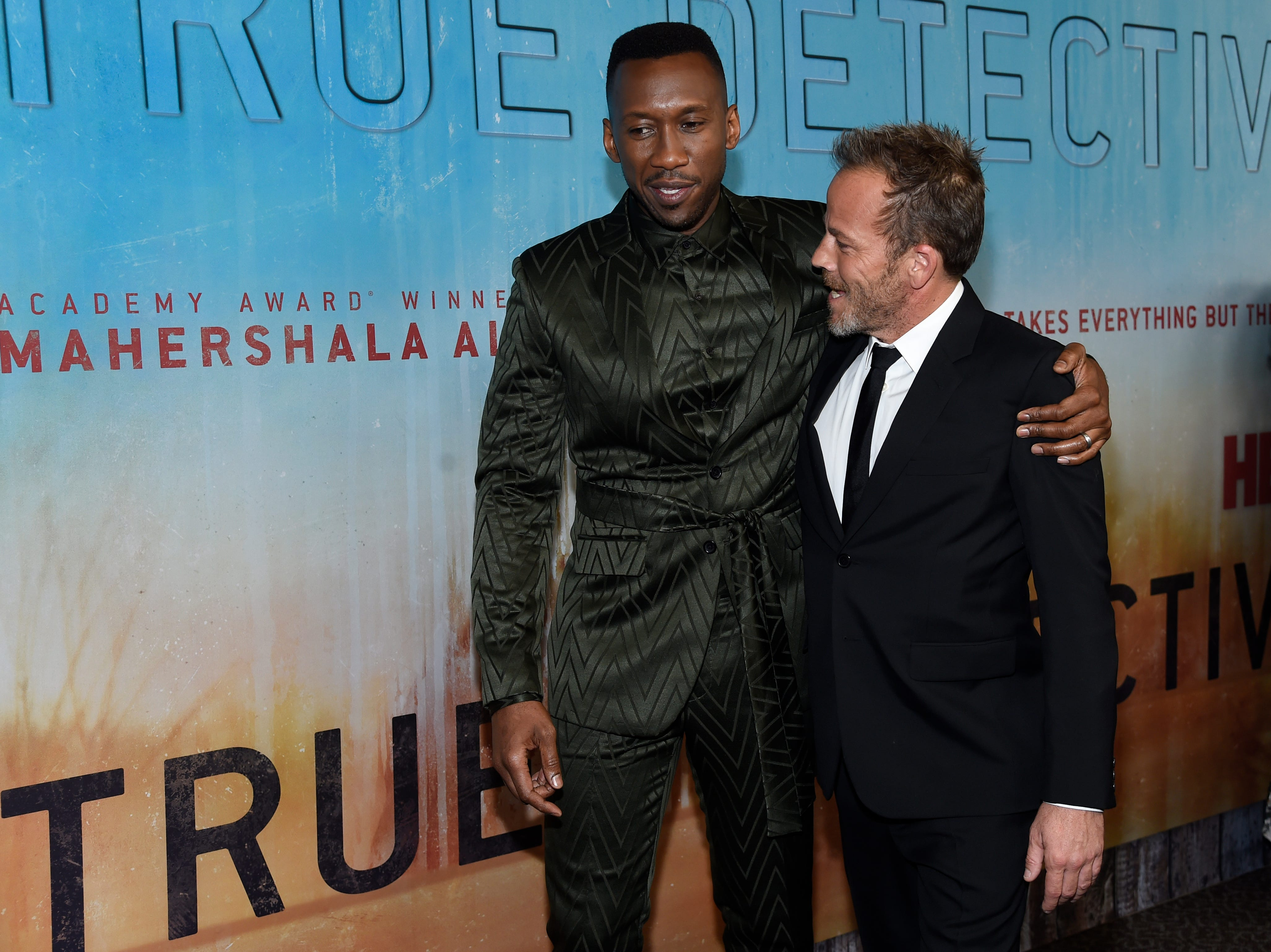 """Mahershala Ali, left, and Stephen Dorff speak as they arrive at the Los Angeles premiere of """"True Detective"""" season 3 at the Directors Guild of America on Thursday, Jan. 10, 2019."""
