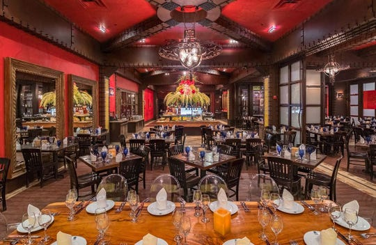 Decor at an existing Texas de Brazil Churrascaria restaurant combines deep jewel tones with Lucite chairs and elaborate light fixtures. The Texas-based chain plans to open a location in Ventura County.
