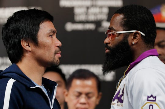 Manny Pacquiao, left, and Adrien Broner pose during a news conference Wednesday in Las Vegas. The two are scheduled to fight in a welterweight championship bout Saturday.