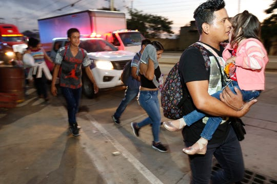 U.S.-bound migrants leave San Pedro Sula, Honduras, at dawn Tuesday, seeking to reach the U.S. border, following the same route as thousands on at least three caravans last year.