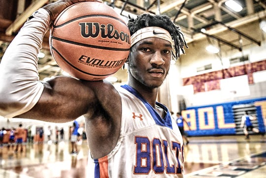 Millville High School senior Rynell Lawrence poses for the camera in the school's gymnasium on Tuesday, Jan. 16, 2019.