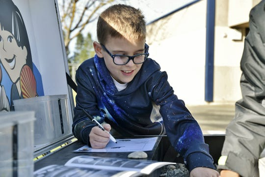 Hurley Elementary fifth-grader Tristan Skimore participates in an activity during the Seed Survivor mobile classroom exhibit at the campus on Thursday, January 16, 2019.