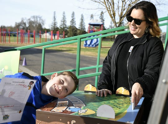 A Hurley Elementary fifth-grader participates in an activity during the Seed Survivor mobile classroom exhibit at the campus on Thursday, January 16, 2019.