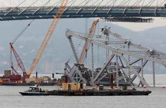 Cranes and barges surround the Tappan Zee Bridge in the Hudson River, a day after it was imploded, as seen from Tarrytown Jan. 16, 2019.