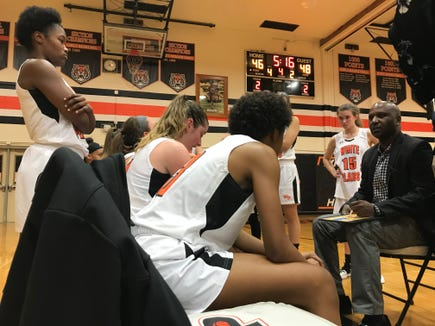 White Plains head coach Benjamin Carter talks to his team during a timeout in a game against Mount Vernon. Jan. 15, 2019.